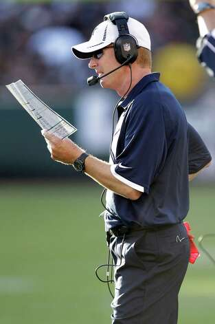 Dallas Cowboys head coach Jason Garrett stands on the sideline during the third quarter of an NFL preseason football game against the Oakland Raiders in Oakland, Calif., Monday, Aug. 13, 2012. (AP Photo/Ben Margot) Photo: Ben Margot, Associated Press / AP
