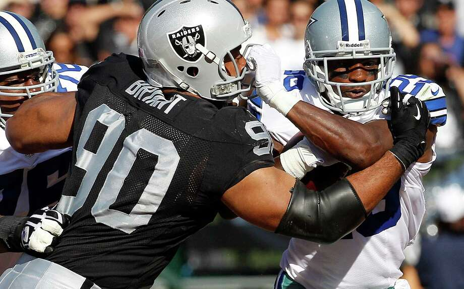 Oakland Raiders defensive tackle Desmond Bryant (90) tackles Dallas Cowboys running back Felix Jones (28) during the first quarter of an NFL preseason football game in Oakland, Calif., Monday, Aug. 13, 2012. (AP Photo/Tony Avelar) Photo: Tony Avelar, Associated Press / FR155217 AP