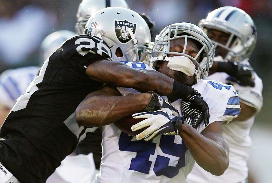 Oakland Raiders defensive back Brandon Underwood (28) tackles Dallas Cowboys running back Jamize Olawale (49) during the third quarter of an NFL preseason football game in Oakland, Calif., Monday, Aug. 13, 2012. (AP Photo/Ben Margot) Photo: Ben Margot, Associated Press / AP