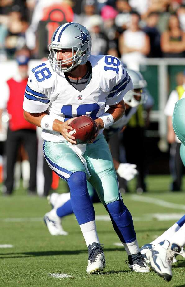 Dallas Cowboys quarterback Kyle Orton (18) hands off against the Oakland Raiders during the first half of an NFL preseason football game in Oakland, Calif., Monday, Aug. 13, 2012. (AP Photo/Tony Avelar) Photo: Tony Avelar, Associated Press / FR155217 AP