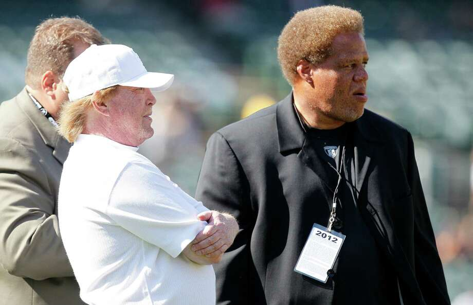 Oakland Raiders owner Mark Davis, left, talks with general manager Reggie McKenzie before an NFL preseason football game against the Dallas Cowboys in Oakland, Calif., Monday, Aug. 13, 2012. (AP Photo/Tony Avelar) Photo: Tony Avelar, Associated Press / FR155217 AP