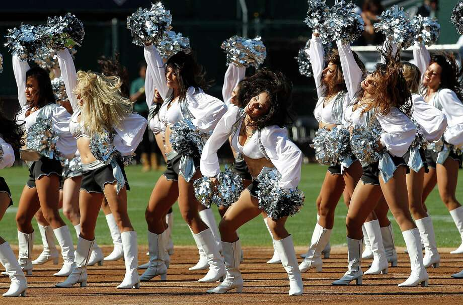 Oakland Raiders cheerleaders perform during an NFL preseason football game against the Dallas Cowboys in Oakland, Calif., Monday, Aug. 13, 2012. (AP Photo/Tony Avelar) Photo: Tony Avelar, Associated Press / FR155217 AP