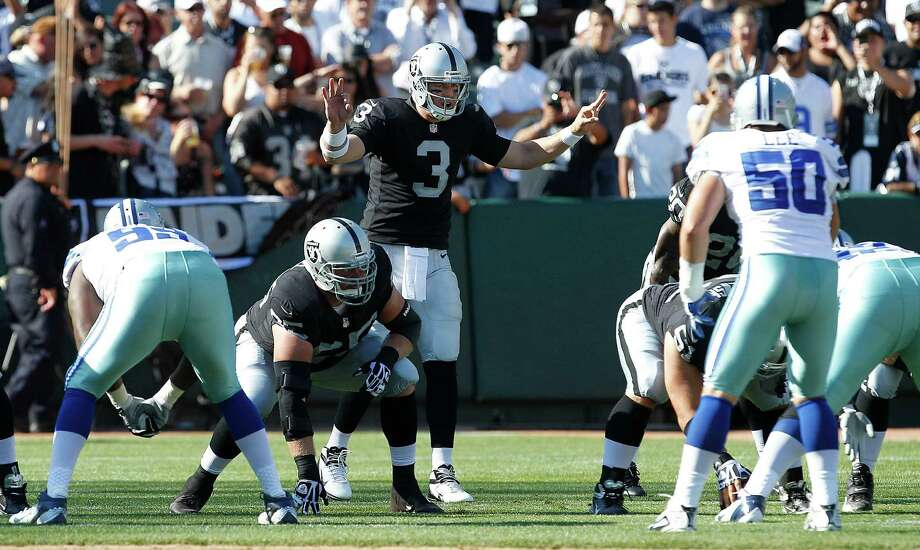Oakland Raiders quarterback Carson Palmer (3) calls a play at the line of scrimmage during the first quarter of an NFL preseason football game against the Dallas Cowboys in Oakland, Calif., Monday, Aug. 13, 2012. (AP Photo/Tony Avelar) Photo: Tony Avelar, Associated Press / FR155217 AP