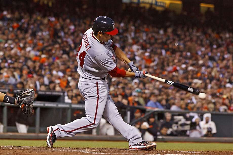 Kurt Suzuki punctuated his Bay Area return with three hits, including this bases-loaded double in the third inning. Photo: Jason O. Watson, Getty Images
