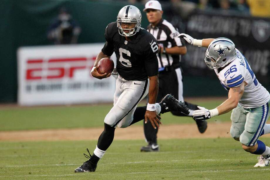 4698 x 3138~~$~~Oakland Raiders quarterback Terrelle Pryor (6) scrambles against Dallas Cowboys linebacker Caleb McSurdy (56) during the second half of an NFL preseason football game in Oakland, Calif., Monday, Aug. 13, 2012. Photo: Tony Avelar, AP / FR155217 AP