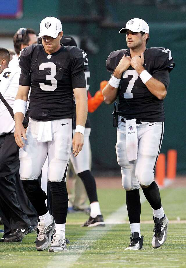 Oakland Raiders quarterback Carson Palmer (3) and quarterback Matt Leinart (7) against the Dallas Cowboys during the second half of an NFL preseason football game in Oakland, Calif., Monday, Aug. 13, 2012. (AP Photo/Tony Avelar) Photo: Tony Avelar, Associated Press / FR155217 AP