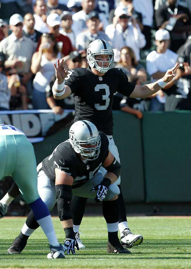 Oakland Raiders quarterback Carson Palmer (3) calls a play at the line of scrimmage against the Dallas Cowboys during the first quarter of an NFL preseason football game in Oakland, Calif., Monday, Aug. 13, 2012. (AP Photo/Tony Avelar) Photo: Tony Avelar, Associated Press / FR155217 AP