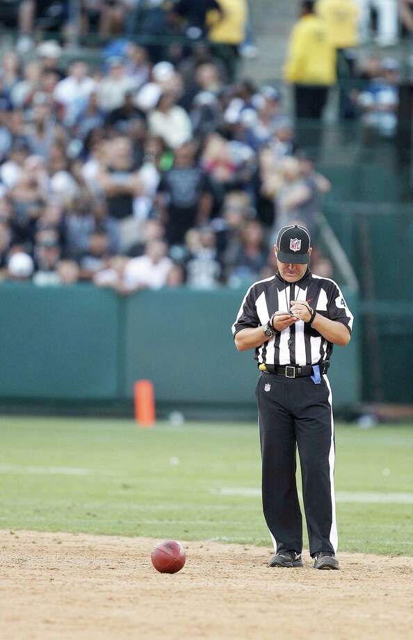 An NFL official is shown during the second half of an NFL preseason football game between the Oakland Raiders and the Dallas Cowboys in Oakland, Calif., Monday, Aug. 13, 2012. (AP Photo/Tony Avelar) Photo: Tony Avelar, Associated Press / FR155217 AP