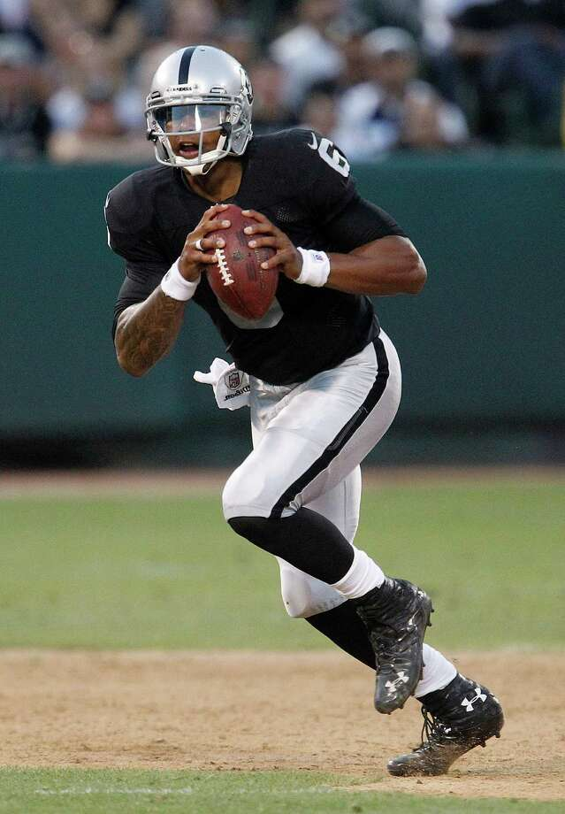 Oakland Raiders quarterback Terrelle Pryor (6) scrambles against the Dallas Cowboys during the second half of an NFL preseason football game in Oakland, Calif., Monday, Aug. 13, 2012. (AP Photo/Tony Avelar) Photo: Tony Avelar, Associated Press / FR155217 AP