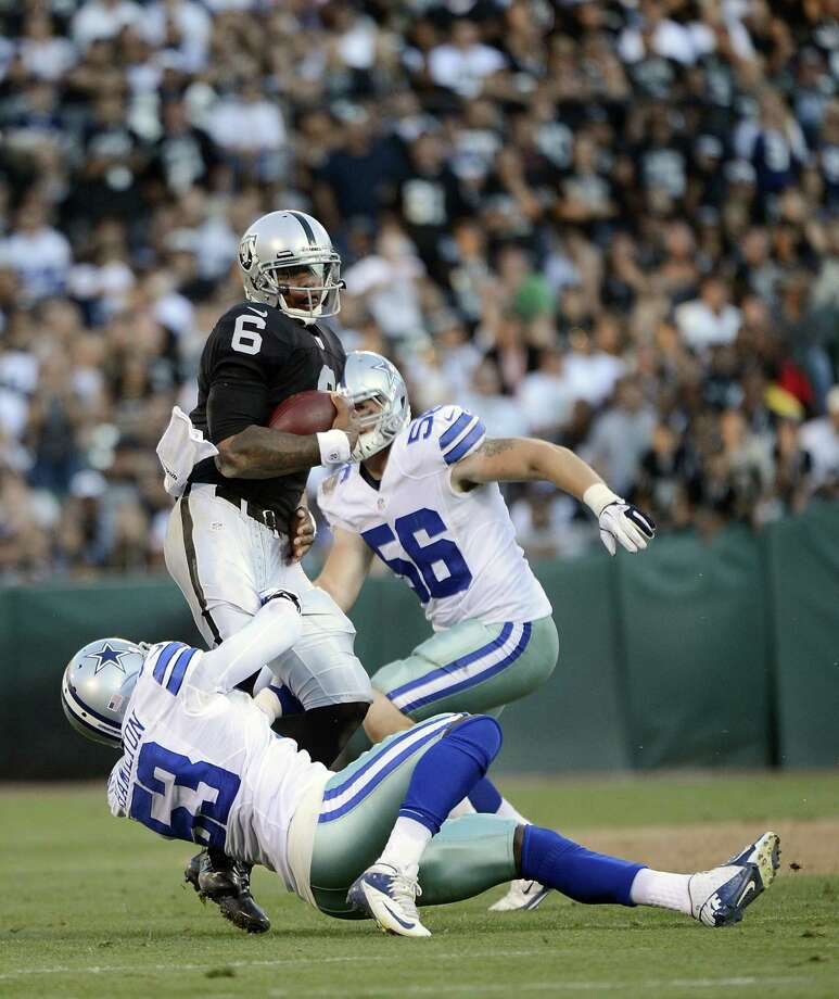 Terrelle Pryor #6 of the Oakland Raiders gets tackled by Adrian Hamilton #53 of the Dallas Cowboys in the fourth quarter of an NFL pre-season football game at O.co Coliseum on August 13, 2012 in Oakland, California. The Cowboys won the game 3-0. Photo: Thearon W. Henderson, Getty Images / 2012 Getty Images