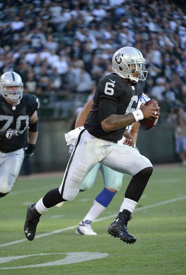 Terrelle Pryor #6 of the Oakland Raiders scrables away from the rush against the Dallas Cowboys in the third quarter of an NFL pre-season football game at O.co Coliseum on August 13, 2012 in Oakland, California. The Cowboys won the game 3-0. Photo: Thearon W. Henderson, Getty Images / 2012 Getty Images