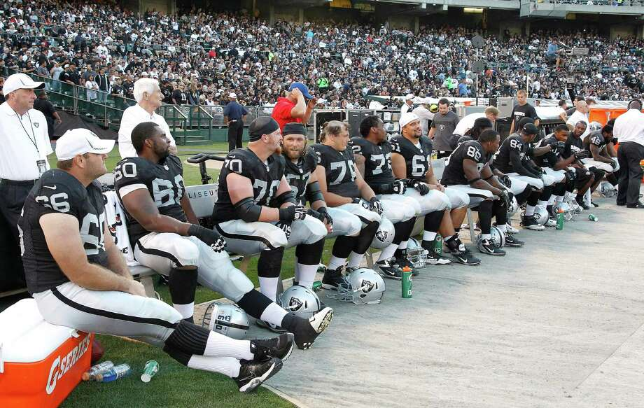 Oakland Raiders players sit on the bench during the second half of an NFL preseason football game against the Dallas Cowboys in Oakland, Calif., Monday, Aug. 13, 2012. (AP Photo/Tony Avelar) Photo: Tony Avelar, Associated Press / FR155217 AP