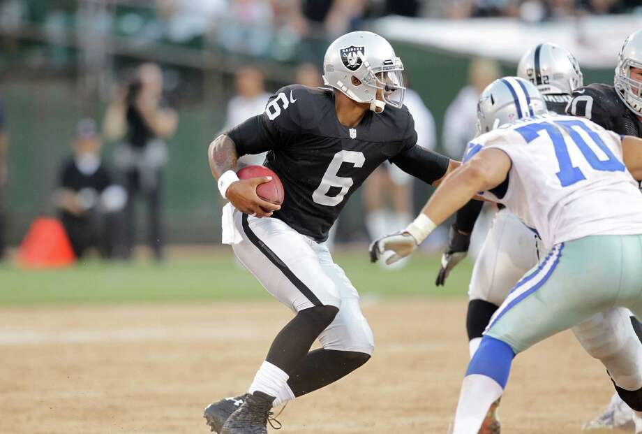 Oakland Raiders quarterback Terrelle Pryor (6) scrambles against the Dallas Cowboys during the second half of an NFL preseason football game in Oakland, Calif., Monday, Aug. 13, 2012. (AP Photo/Ben Margot) Photo: Ben Margot, Associated Press / AP