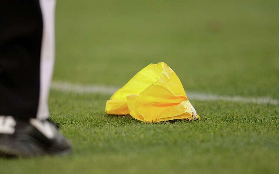 A penalty flag is shown during an NFL preseason football game between the Oakland Raiders and the Dallas Cowboys in Oakland, Calif., Monday, Aug. 13, 2012. (AP Photo/Ben Margot) Photo: Ben Margot, Associated Press / AP