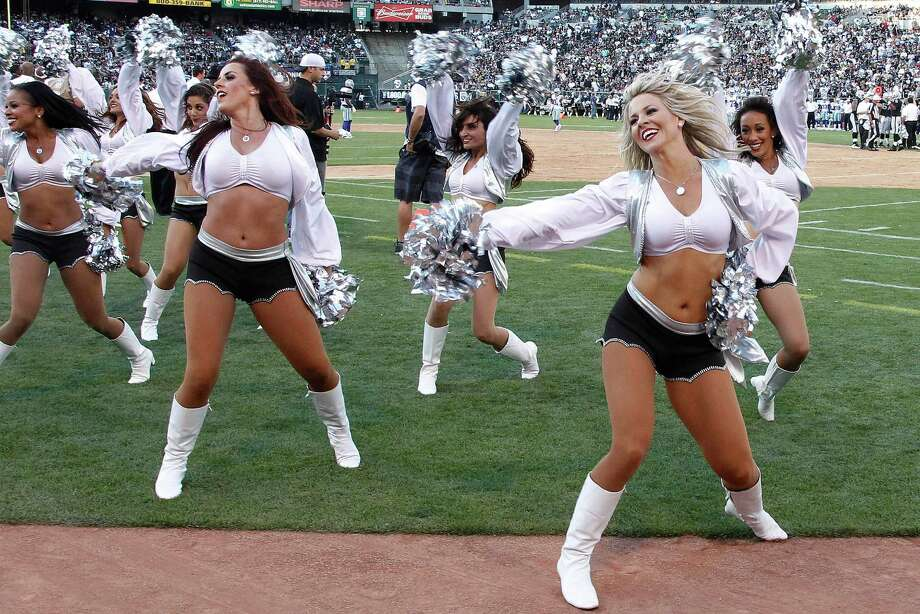 Oakland Raiders cheerleaders perform during the second half of an NFL preseason football game against the Dallas Cowboys in Oakland, Calif., Monday, Aug. 13, 2012. (AP Photo/Tony Avelar) Photo: Tony Avelar, Associated Press / FR155217 AP