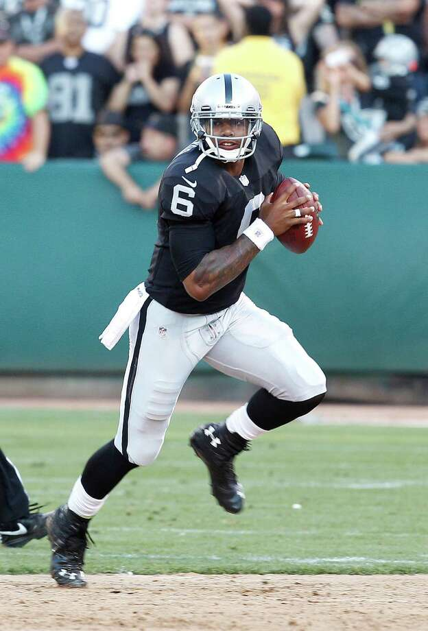 Oakland Raiders quarterback Terrelle Pryor (6) against the Dallas Cowboys during the second half of an NFL preseason football game in Oakland, Calif., Monday, Aug. 13, 2012. (AP Photo/Tony Avelar) Photo: Tony Avelar, Associated Press / FR155217 AP