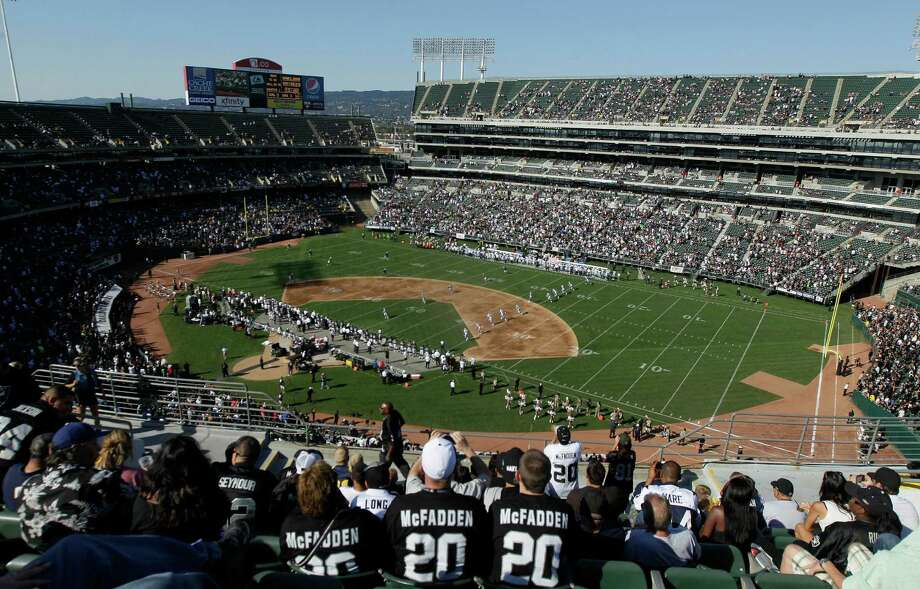 Fans at O.co Coliseum watch an NFL preseason football game between the Oakland Raiders and the Dallas Cowboys in Oakland, Calif., Monday, Aug. 13, 2012. (AP Photo/Aaron Kehoe) Photo: Aaron Kehoe, Associated Press / AP