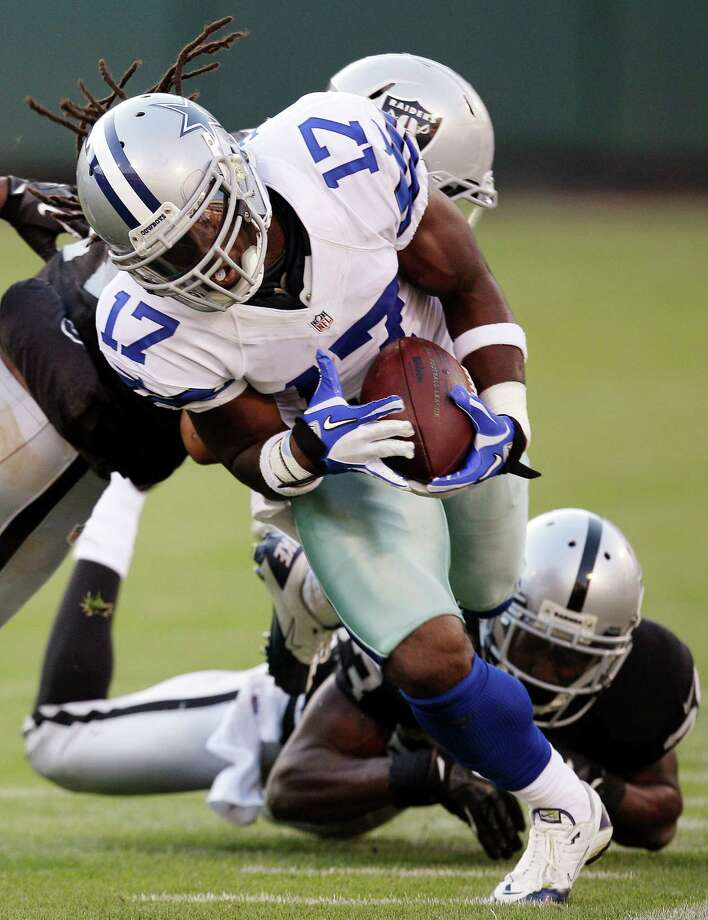 Dallas Cowboys wide receiver Dwayne Harris (17) runs against the Oakland Raiders during the second half of an NFL preseason football game in Oakland, Calif., Monday, Aug. 13, 2012. (AP Photo/Ben Margot) Photo: Ben Margot, Associated Press / AP