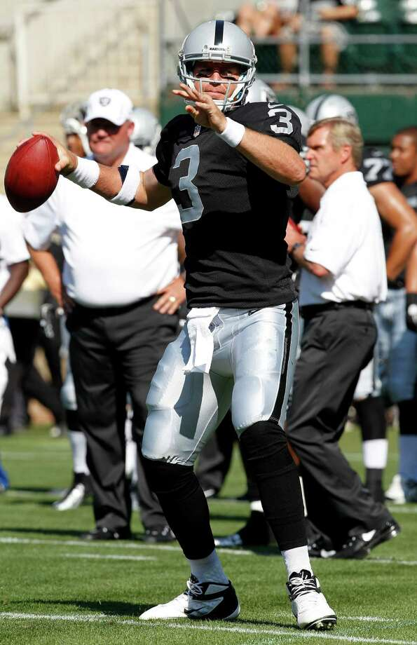 Oakland Raiders quarterback Carson Palmer (3) before an NFL preseason football game against the Dallas Cowboys in Oakland, Calif., Monday, Aug. 13, 2012. (AP Photo/Tony Avelar) Photo: Tony Avelar, Associated Press / FR155217 AP