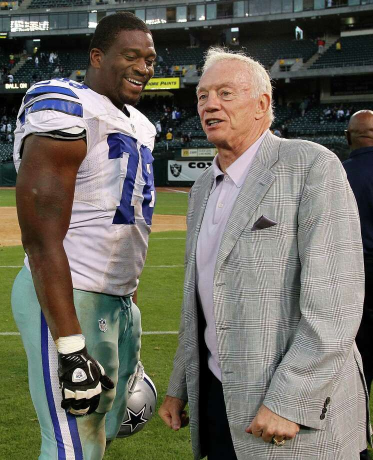 Cowboys offensive tackle Jermey Parnell talks with owner Jerry Jones after Monday's preseason game. Jones is optimistic about the team's offensive line despite its showing against the Oakland Raiders. Photo: Tony Avelar, Associated Press / FR155217 AP
