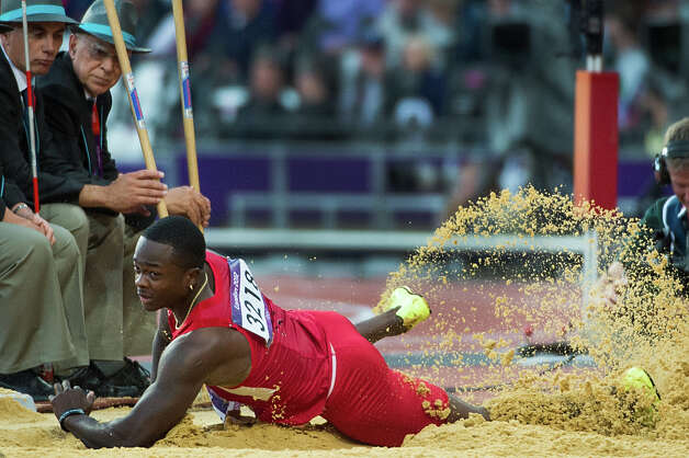 Marquise Goodwin of the USA hits the landing pit to make the automatic qualifying distance on his first attempt during the mens long jump qualification at the 2012 London Olympics on Friday, Aug. 3, 2012. Photo: Smiley N. Pool, Houston Chronicle / © 2012  Houston Chronicle