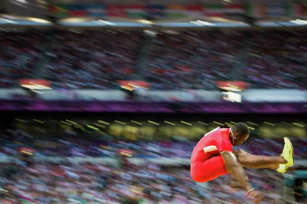 Marquise Goodwin of the USA competes in the men's long jump final at the 2012 London Olympics on Saturday, Aug. 4, 2012. Photo: Smiley N. Pool, Houston Chronicle / © 2012  Houston Chronicle