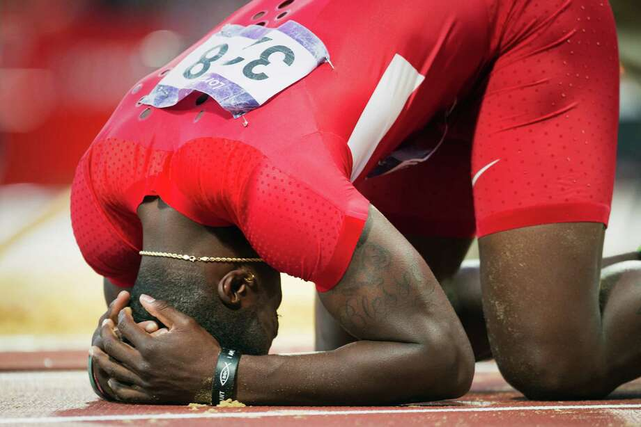 Marquise Goodwin of the USA collapses to the track after failing to advance in the men's long jump final at the 2012 London Olympics on Saturday, Aug. 4, 2012. The Texas Longhorns wide receiver finished in 10th place. Photo: Smiley N. Pool, Houston Chronicle / © 2012  Houston Chronicle