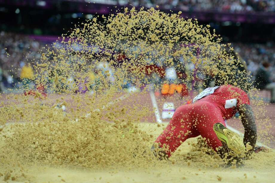 US' Marquise Goodwin competes during the men's long jump at the athletics event of the London 2012 Olympic Games on August 4, 2012 in London.  AFP PHOTO / FRANCK FIFEFRANCK FIFE/AFP/GettyImages Photo: FRANCK FIFE, AFP/Getty Images / AFP