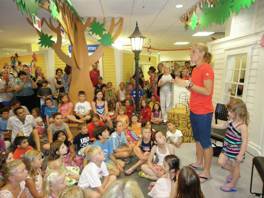 Two-time gold medalist from the US Olympic soccer teams Kristine Lilly shared her love for the sport with several hundred children and adults at the Fairfield Public Library on Friday at the closing ceremony of the library's Victorious Visitor summer reading program. Photo: Meg Barone / Fairfield Citizen freelance