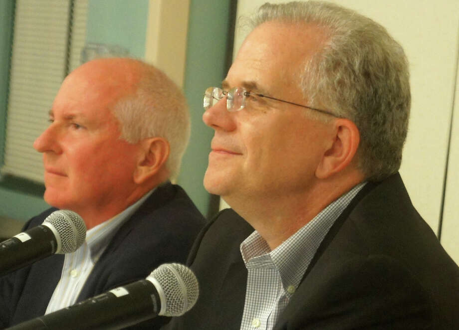 Board of Education Chairman Don O'Day, right, resigned from the post Monday night, saying he wants to focus more attention on his profession. He recommended Jim Marpe, left, the board's vice chariman, succeed him as chairman. Photo: Paul Schott / Westport News