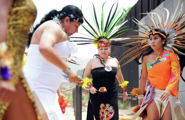"Aztec dancers perform at the Border Field State Park fence, which separates the cities of San Diego and Tijuana at the US-Mexico border on August 12, 2012 in San Diego, California, at the launch of ""caravan for peace"" across the United States, a month-long campaign to protest the two countries' brutal drug war.  The caravan departed from Tijuana with about 250 participants and is due to end in Washington on September 10.     AFP PHOTO / Frederic J. BROWN        (Photo credit should read FREDERIC J. BROWN/AFP/GettyImages) Photo: Getty Images"