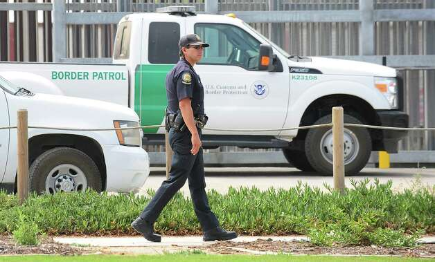 "A California State Parks guard walks past the fence at Border Field State Park, which separates the cities of San Diego and Tijuana, on August 12, 2012 in San Diego, California, at the launch of ""caravan for peace"" across the United States, a month-long campaign to protest the two countries' brutal drug war.  The caravan departed from Tijuana with about 250 participants and is due to end in Washington on September 10.    AFP PHOTO / Frederic J. BROWN        (Photo credit should read FREDERIC J. BROWN/AFP/GettyImages) Photo: Getty Images"