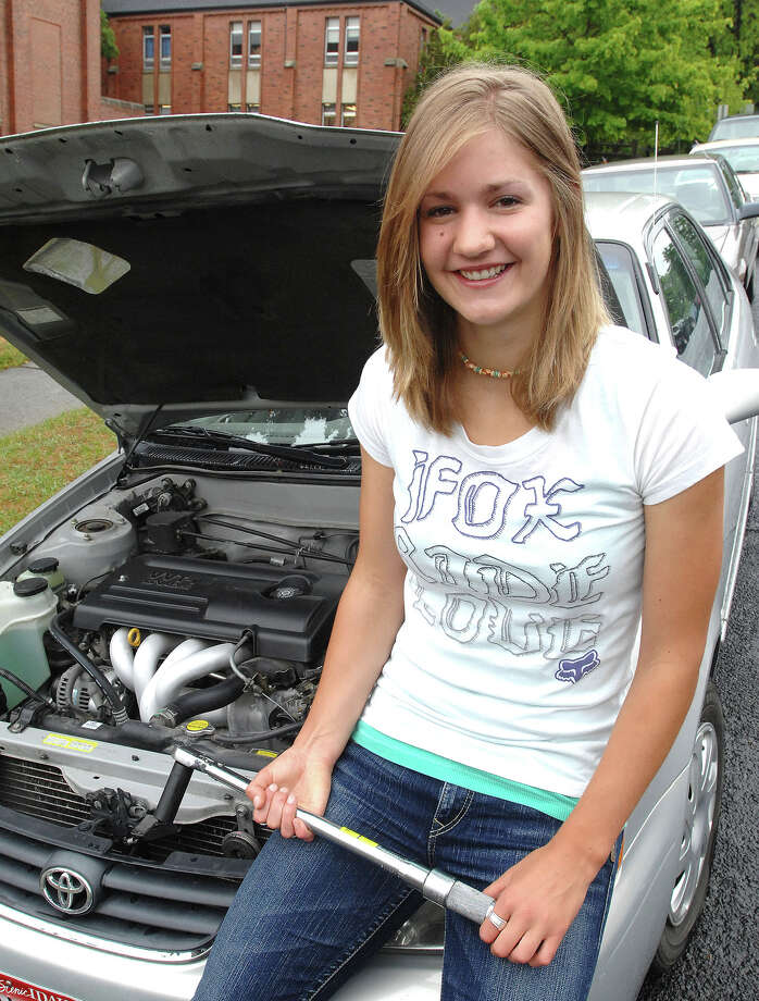 In this June 9, 2010 photo, Anne Veseth, of Moscow, Idaho, talks about going to college to learn auto mechanics. Veseth, who later became a firefighter with the U.S. Forest Service, was killed Sunday when she was struck by a falling tree while working on a wildfire in northern Idaho. She was 20. (AP Photo/Lewiston Tribune, Kyle Mills) Photo: Associated Press