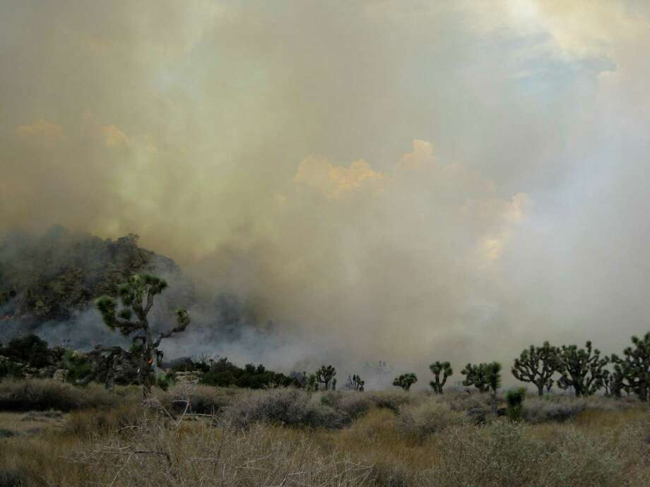 In this Sunday photo provided by the Joshua Tree National Park, a 300-acre fire believed to have been sparked by lightning from Sunday's thunderstorms burns in Joshua Tree National Park east of Palm Springs, Calif. A 220-acre blaze is near Vallecito in San Diego County, also believed to have been sparked by lightning from Sunday's thunderstorms, is burning out of control but no homes are nearby. Photo: Ap