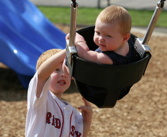 Lukaz Kozloski, 5,  gives his sister, Morgann, 8 months, a push at Fowler field in Milford, Conn. on Monday, August 13, 2012. Photo: Unknown, B.K. Angeletti / Connecticut Post freelance B.K. Angeletti