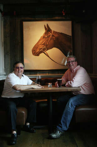 Owners, Tommy Febbraio, left,  and George E. O'Connell, sit in a horseshoe booth in the bar at the Spotted Horse Tavern in Westport, Conn. Monday, August 13, 2012. Photo: Unknown, B.K. Angeletti / Connecticut Post freelance B.K. Angeletti