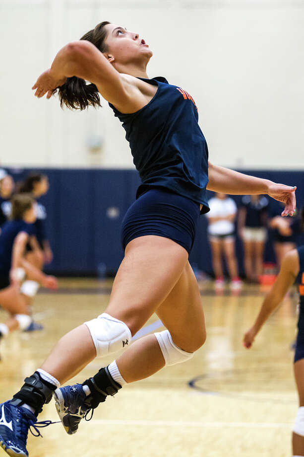 Brandeis senior Alex Parker goes up for a kill shot during a scrimmage session at the O'Connor gym on Aug. 10, 2012.  Photo by Marvin Pfeiffer / Prime Time Newspapers Photo: MARVIN PFEIFFER, Marvin Pfeiffer / Prime Time New / Prime Time Newspapers 2012