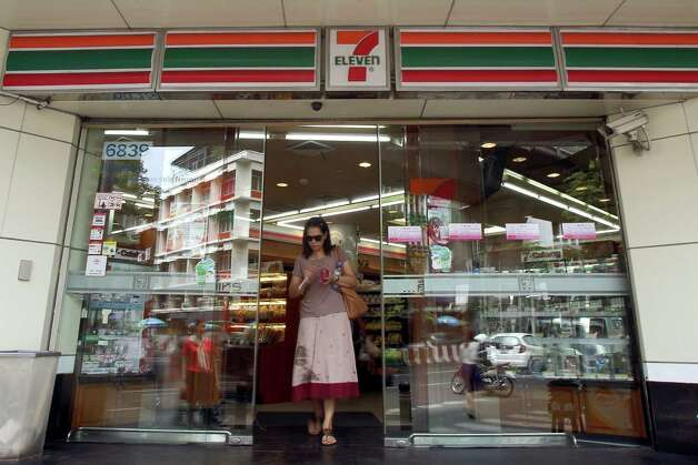 A customer exits a 7-Eleven convenience store, operated by CP All Pcl, in Bangkok, Thailand, on Thursday, Aug. 9, 2012. CP All is Thailand's biggest convenience store operator. Photographer: Dario Pignatelli/Bloomberg Photo: Dario Pignatelli, Bloomberg / © 2012 Bloomberg Finance LP