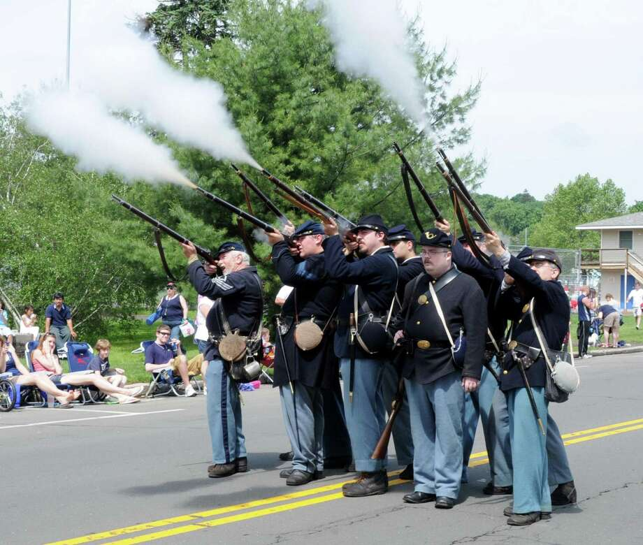 A group of Civil War reenactors of the 11th Regiment Connecticut Volunteer Infantry Co. A are expected to be a part of the festivities when the Norwalk Historical Society is planning a barbecue and history event Saturday, Aug. 18, 2012, at Mill Hill Historic Park in Norwalk. For more information on admission and hours, visit norwalkhistoricalsociety.org or call 203-846-0525. Above, members of the group fire their guns during the Danbury Memorial Day Parade in 2011. Photo: Lisa Weir, ST / The News-Times Freelance