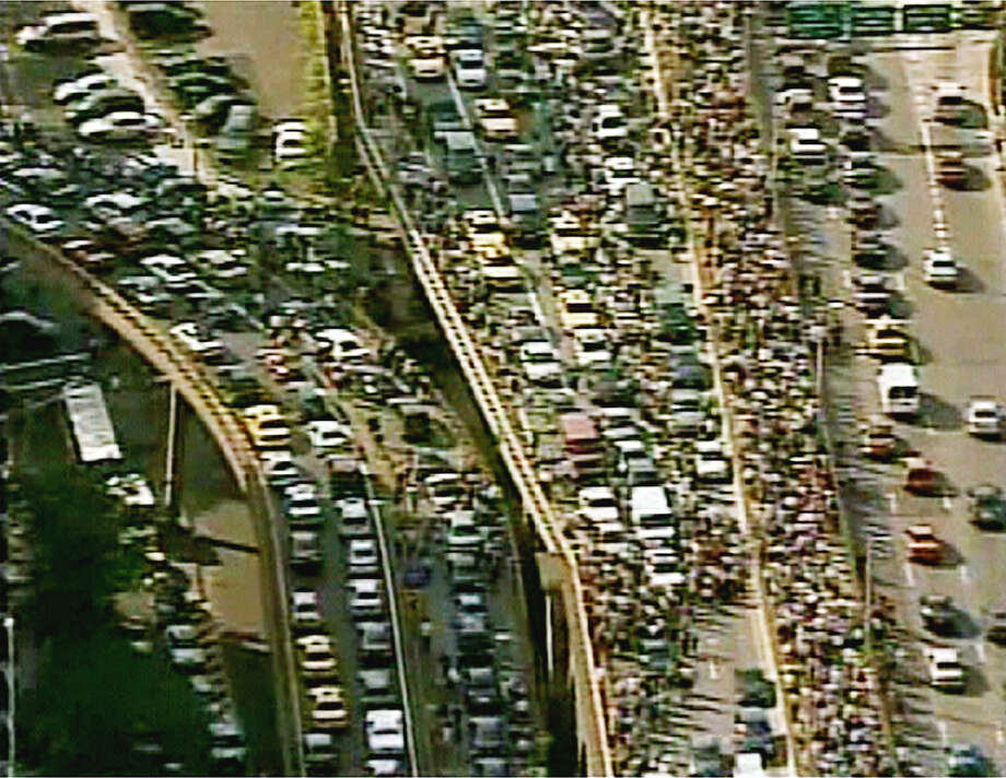 This image from video shows pedestians and motorists crowding sidewalks and highways Thursday, Aug. 14, 2003, in New York, after an extraordinary power blackout hit steamy U.S. and Canadian cities Thursday, stranding people in subways, closing nine nuclear power plants from New York to Michigan and choking streets with workers driven from stifling offices. (AP Photo/ABC-TV)