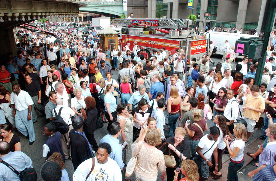 Bystanders gather outside Grand Central Station after a power blackout in  New York City, Thursday, Aug. 14, 2003. A huge power blackout hit U.S. cities spreading from New York to Cleveland and Detroit and north into Canada Thursday afternoon. (AP Photo/Mary Altaffer)