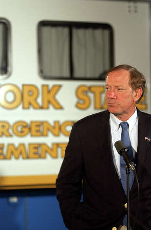 New York Gov. George Pataki listens to a question at a press conference outside the New York State Emergency Office in Albany, N.Y., on Thursday, Aug. 14. 2003, where he said that 60 percent of New York State was still without power. (AP Photo/Jim McKnight)