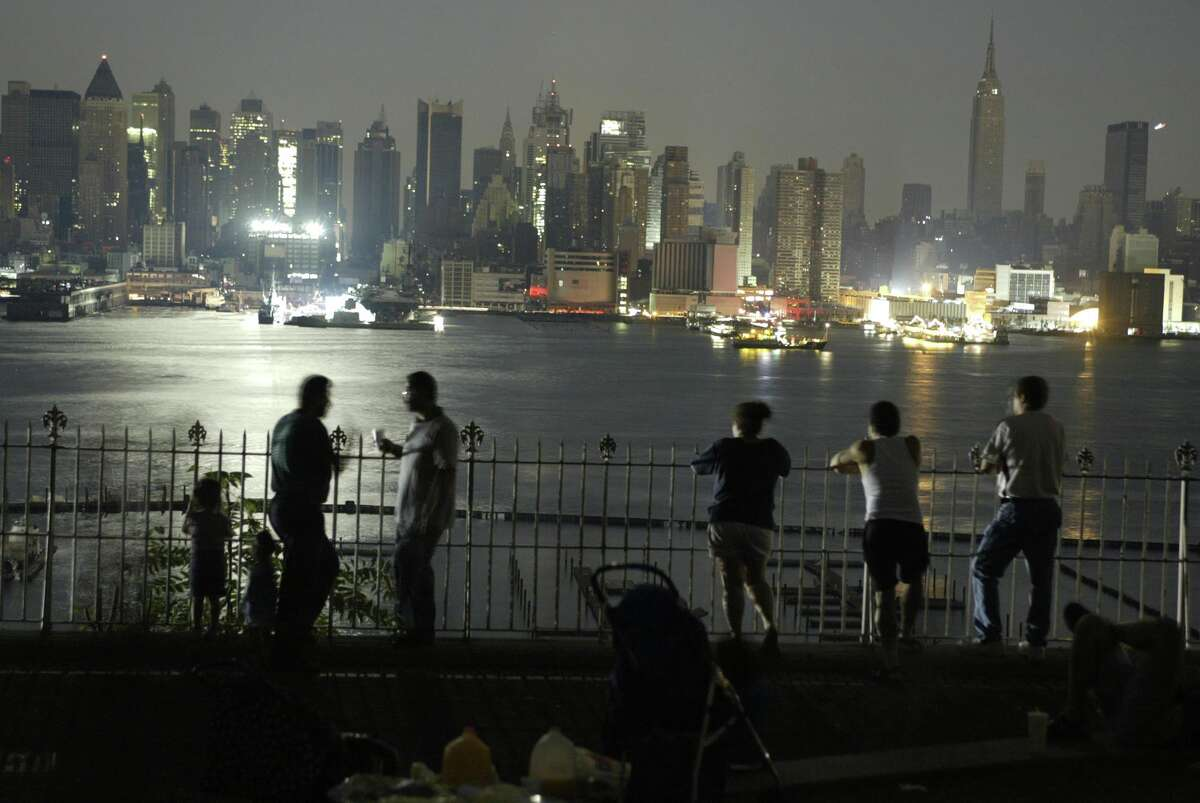 A view of the Upper West side of Manhattan is seen from a Weehawken, N.J. park Thursday, Aug. 14, 2003. The largest power blackout in U.S. history rolled across a vast swath of the northern United States as well as southern Canada on Thursday, driving millions of people outdoors into stifling rush hour streets, then darkness. (AP Photo/George Widman)
