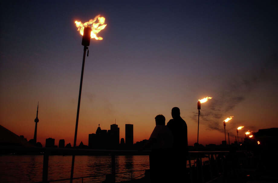 The Toronto Skyline is shown in the background during a blackout seen from Toronto Island at dusk Thursday Aug. 14, 2003. A power outage of unprecedented impact hit huge swaths of Ontario and parts of the United States Thursday, shutting down businesses and causing commuter chaos in sweltering temperatures. (AP Photo/CP, Toronto Star, Andrew Stawicki)