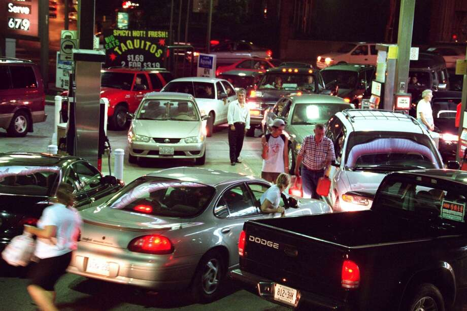 One of the first gas stations in London, Ontario, to get power back is flooded by customers trying to get gasoline and supplies Thursday night, Aug. 14, 2003. Power was restored to London residents by late evening. (AP Photo/London Free Press, Dave Chidley)