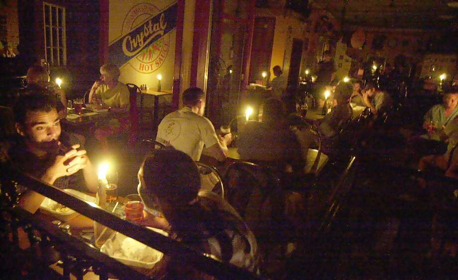 Patrons dine by candlelight at a downtown Peterborough, Canada, restaurant during a blackout  Thursday, Aug. 14, 2003. (CP PHOTO/Peterborough Examiner-Clifford Skarstedt)