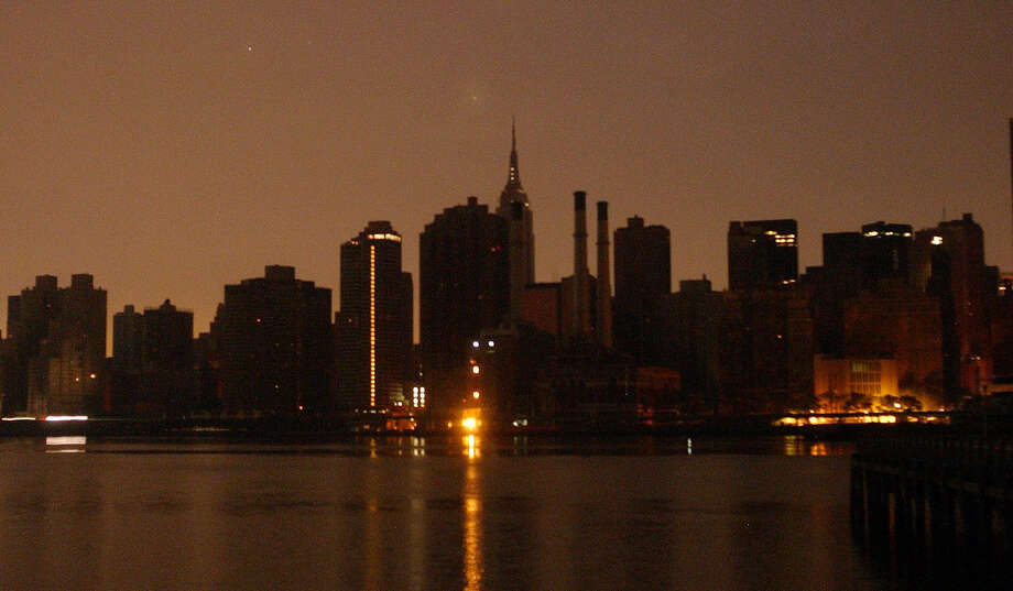 The sun rises over the skyline of the Upper West side of Manhattan as seen from Weehaken, N.J. Friday Aug. 15, 2003. A sudden blackout robbed electricity from millions of people across a vast swath of the northern United States and southern Canada on Thursday.  (AP Photo/Jacqueline Larma)