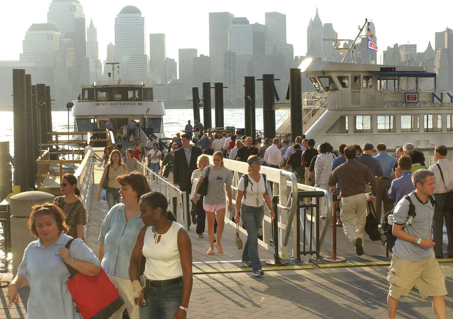 Jersey City, N.J. commuters exit and enter the Waterway Ferry at Grand Street. in Jersey City N.J. , Friday, Aug., 15, 2003. Thursday's power outage caused commuter rail and bus lines to operate on limited schedules and officials said ferry traveler was lower than usual (AP Photo/Brian Branch-Price)