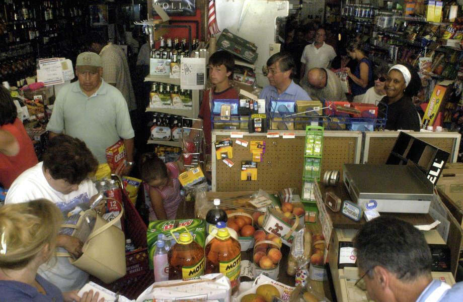 Customers line up to buy supplies Thursday, Aug. 14, 2003 at the Yorkshire Food Market in Detroit after power was lost to much of the eastern United States.  Cities from New York to Toronto to Detroit were left without power after a natural occurrence likely disrupted the power grid near Niagara Falls, N.Y., officials said.  (AP Photo/Paul Warner)