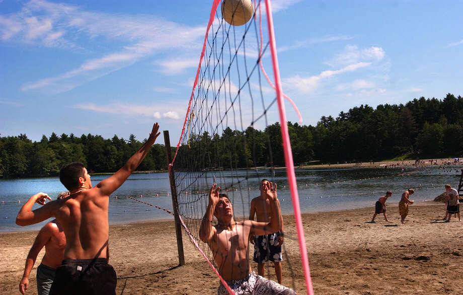 Times Union Staff Photo by Stacey Lauren -- Friday was declared free park day by Governor Pataki in response to the blackout yesterday. Here guys take advantage of the day with a game of volleyball in Grafton State Park. Left is Kevin Buchan of Troy, NY and right Andy Vartigian also of Troy, NY on Friday August 15, 2003 .